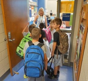 Picture of teacher welcoming students on first day