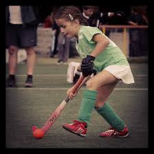 picture of elementary student playing field hockey