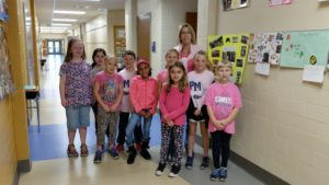 "3rd grade teacher and students in pink for ""PINK OUT"" day"