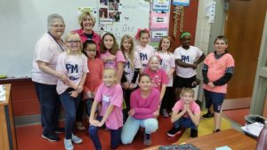 "5th grade teacher and students in pink for ""PINK OUT"" day"