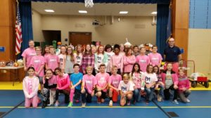 "6th grade teachers and students in pink for ""PINK OUT"" day"