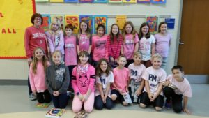 "4th grade teacher and students in pink for ""PINK OUT"" day"