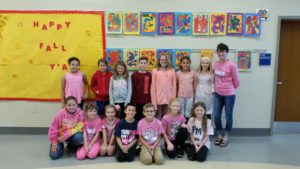 "4th grade teacher and tudents in pink for ""PINK OUT"" day"