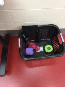 picture of miscellaneous lost and found items in a laundry basket