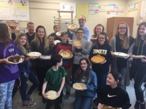 picture of 6th grade students eating pies