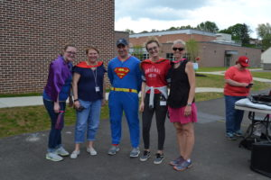 Picture of Cruising for Conestoga fundraiser signs, staff or students