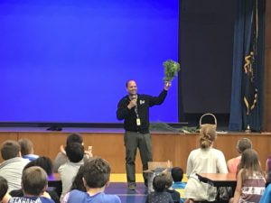 Picture of students at the garden assembly