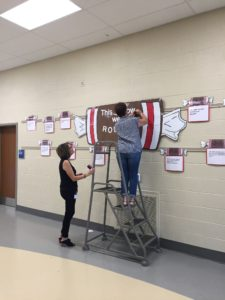 Picture of teachers hanging tootsie roll posters
