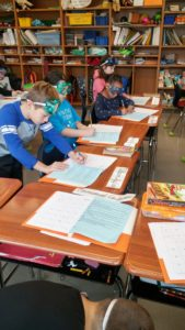picture of students reading science journals