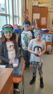 Picture of 3rd grade students with science experiment goggles on