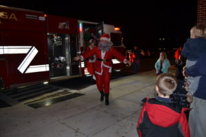 Picture of students being greeted by Santa