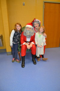 Picture of students with Mr. and Mrs. Claus
